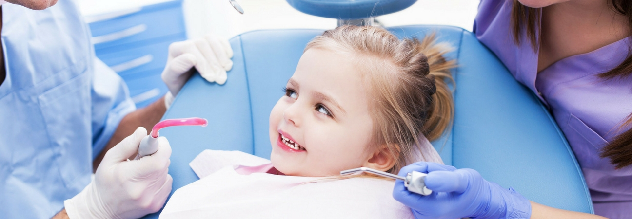 young girl at a dentist appointment, pediatric dental emergency