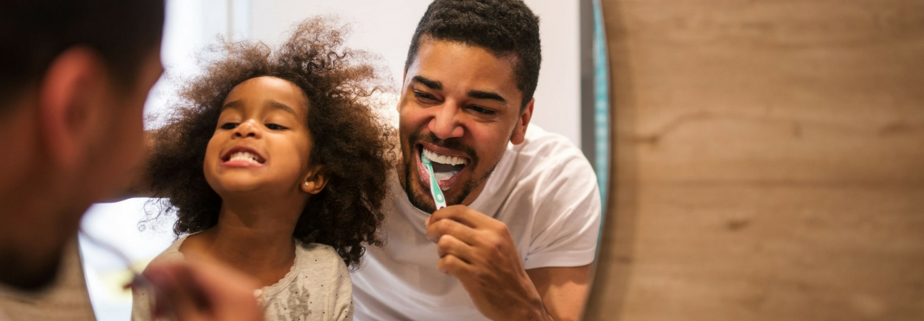 family brushing their teeth, good pediatric dental care