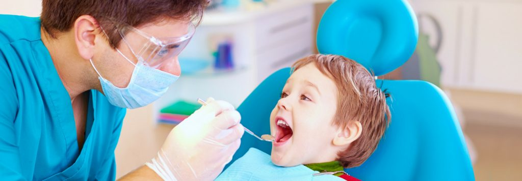 child visits pediatric dentist for orthodontic evaluation